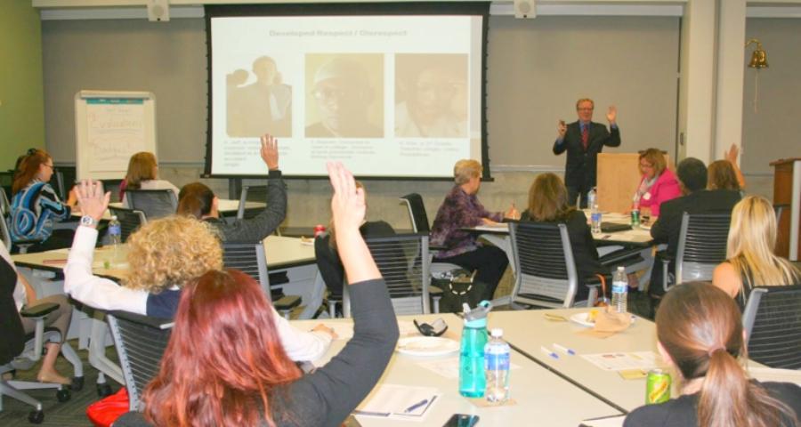 Gregg speaking at HBA event