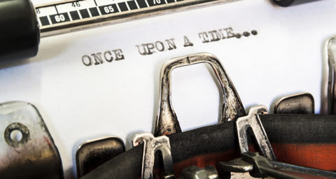 "typewritter close up with ""once upon a time..."" typed on page"