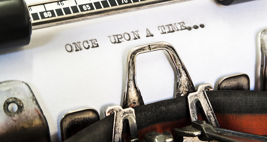 """typewritter close up with """"once upon a time..."""" typed on page"""