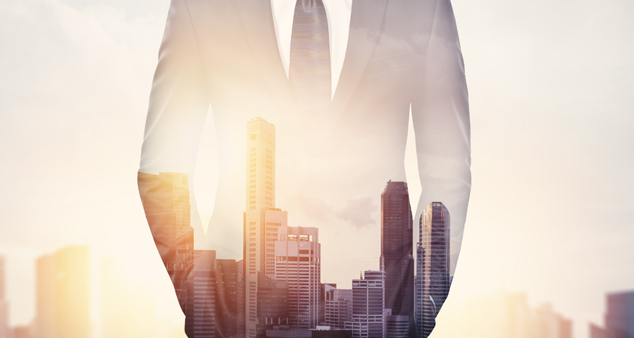 transparent business man with cityscape showing through him
