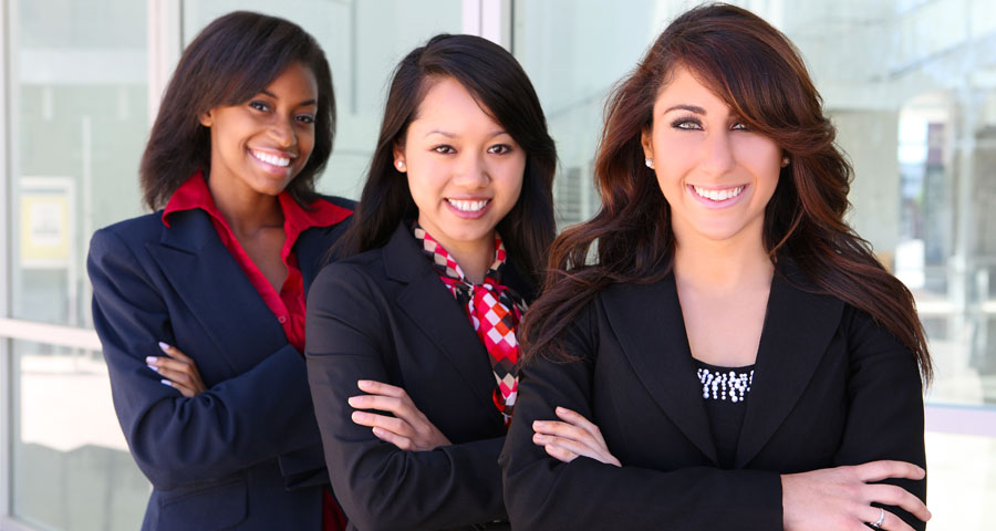 three young female business women