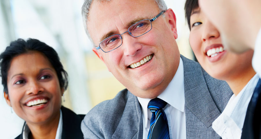 smiling business man and women talking