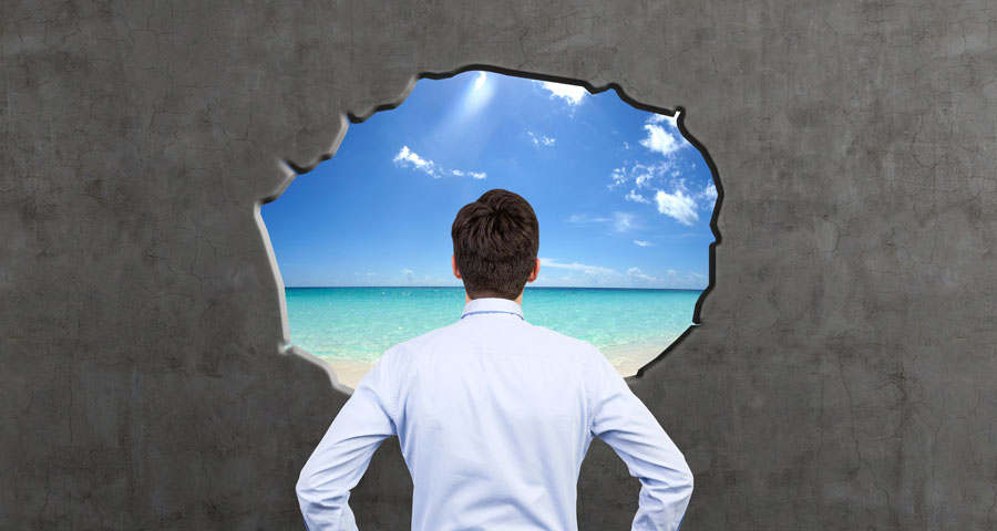 business man looking through hole in wall at a beach