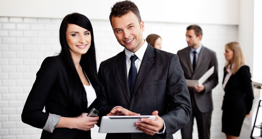 business man and women with tablet computer