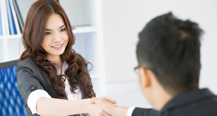 business woman shaking hands with business man