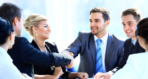 business men shaking hands in a business meeting