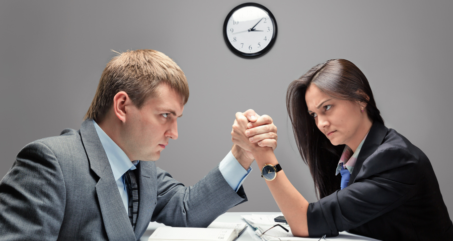 business man and woman arm wrestling