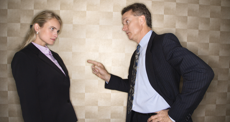 business man reprimanding a business woman