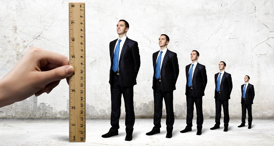 ruler measuring up 3 business men