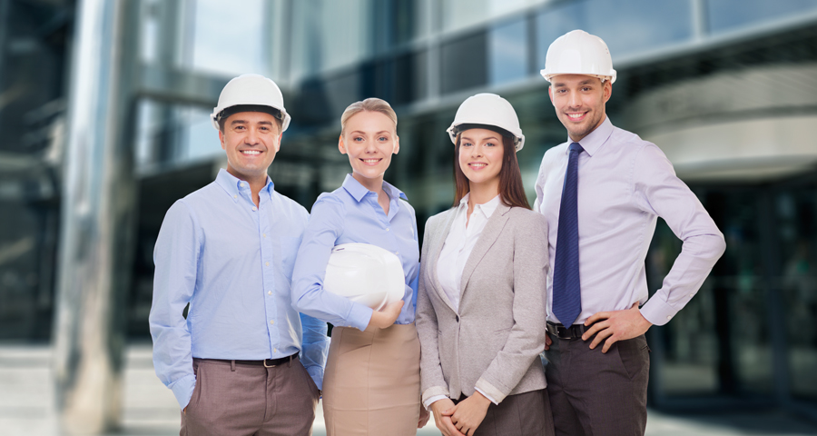 business men and women with hard hats
