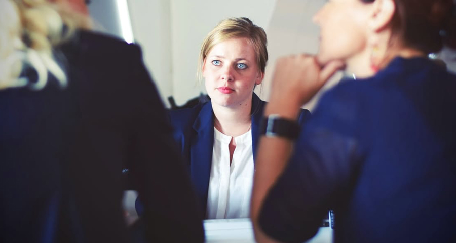 business woman staring at business man and woman
