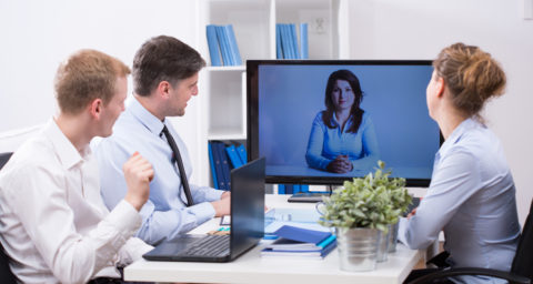 business men and women in a video conference