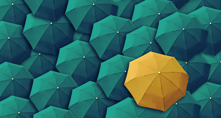 one yellow umbrella in a crowd of green umbrellas