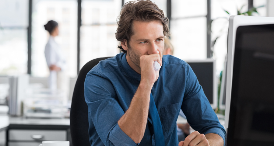 frustrated business man staring at computer