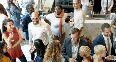 group of professionals networking at a social event