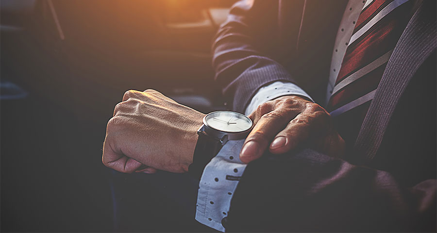 Business man checking his watch