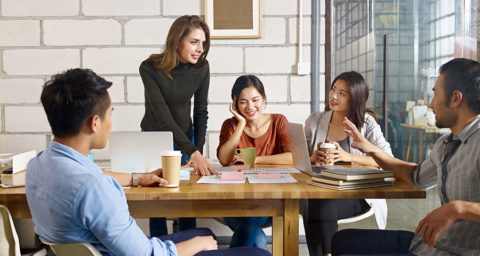 group of young professionals meeting over coffee