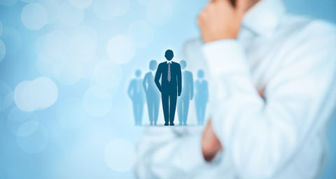 Illustration of business people superimposed over a business man