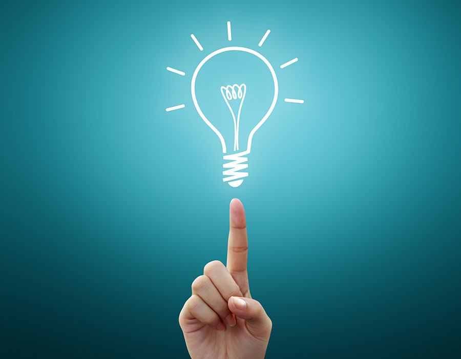 hand pointing to a lightbulb illustration
