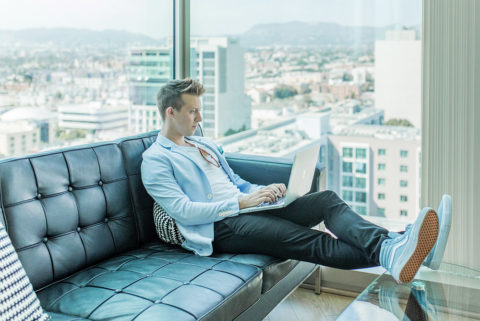 business man working remotely with view of city in backgroud